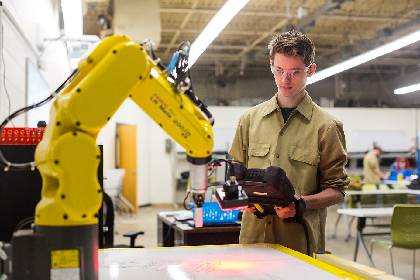 a ATCC student works with an automation robot project