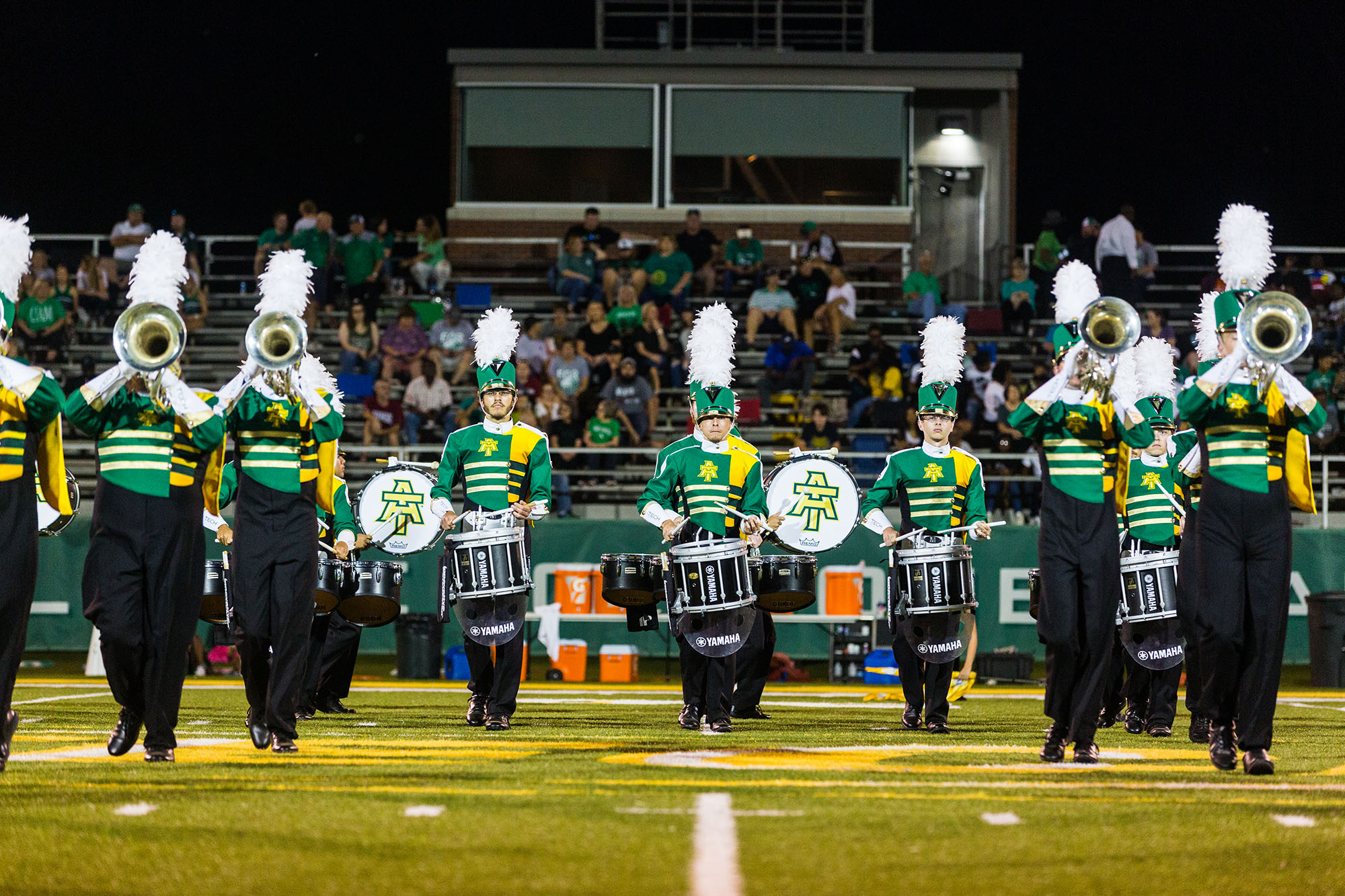 the marching band performs at halftime of an ATU football game