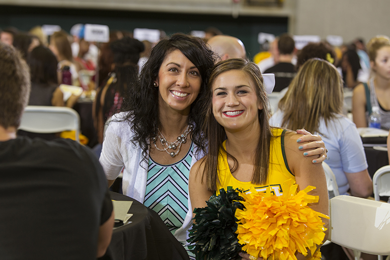 this photo is of a staff member and a tech student at the academic welcome breakfast