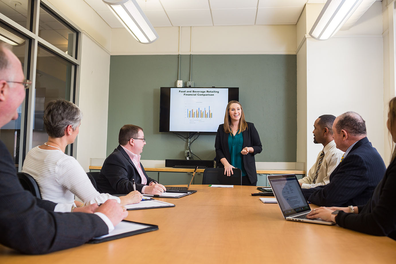 an MBA student presented her research findings to a panel of campus experts