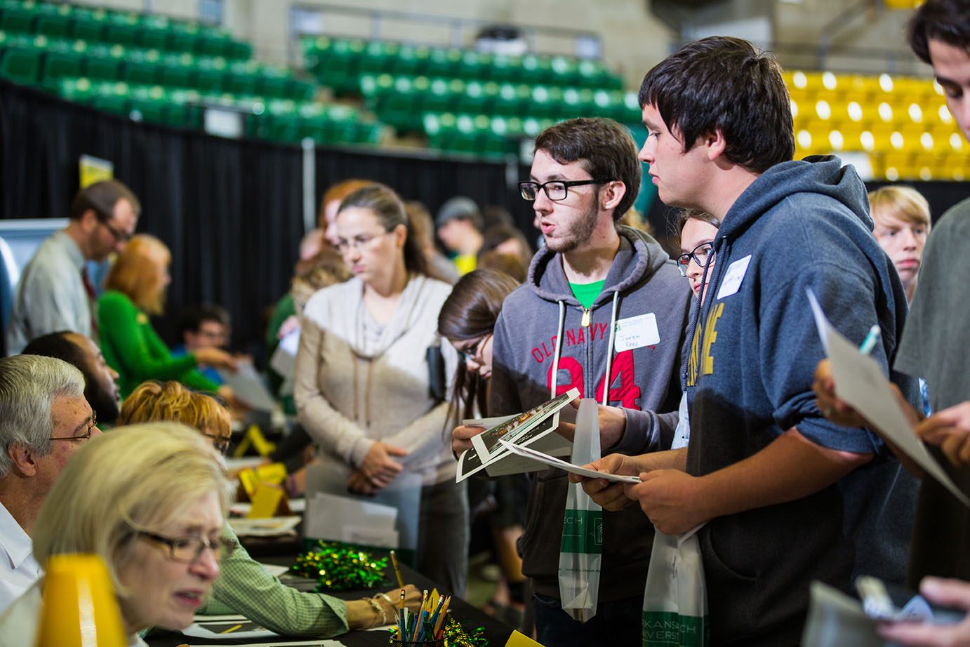 two prospective students speaking with a msuic faculty member at ATU Open House