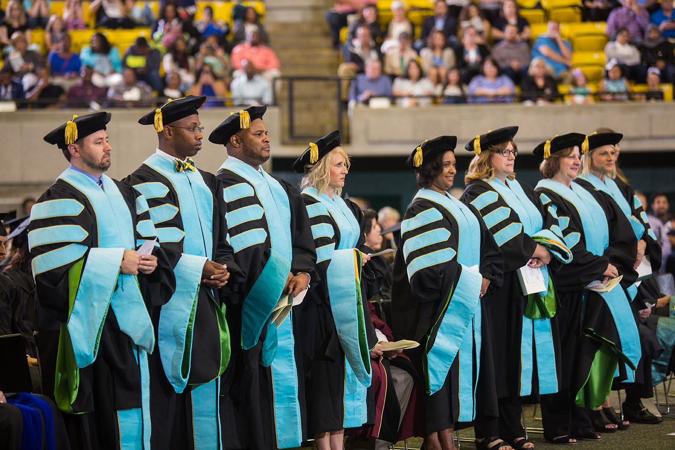 Recipients of Masters Degrees line up at graduation