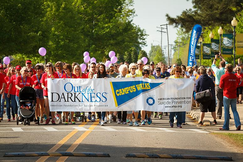 A group marching to raise awareness about the Out of the Darkness suicide prevention initiative.