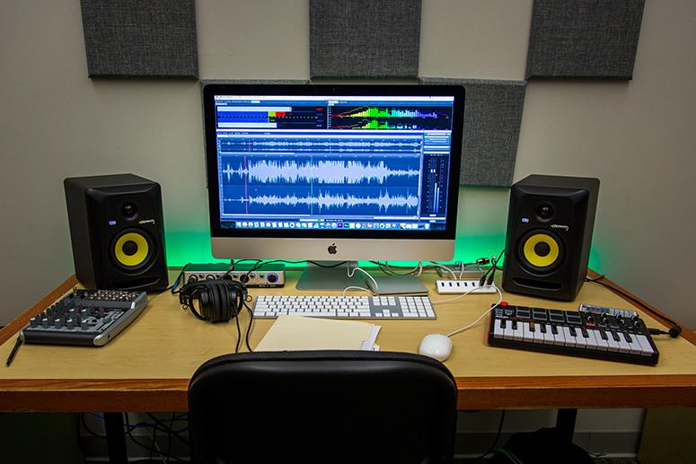 Photo of some of the digital mixing equipment and iMac in the Audio Lab