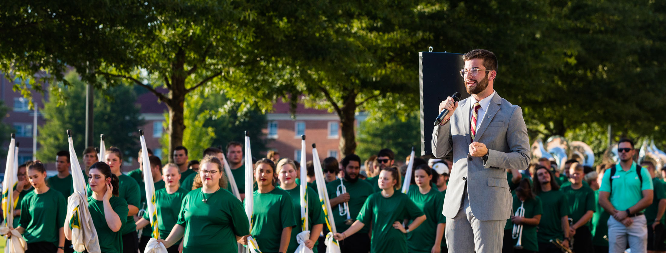 sga president addresses a crowd at paint the town green and gold