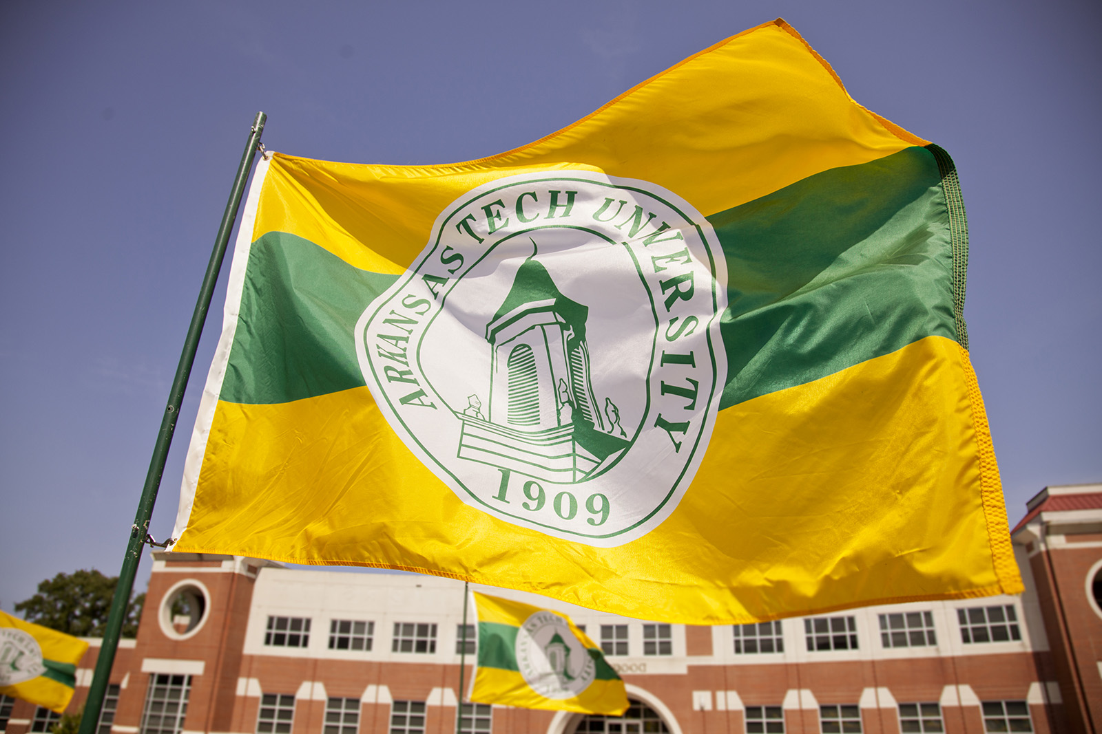The Arkansas Tech University flag blowing in the wind