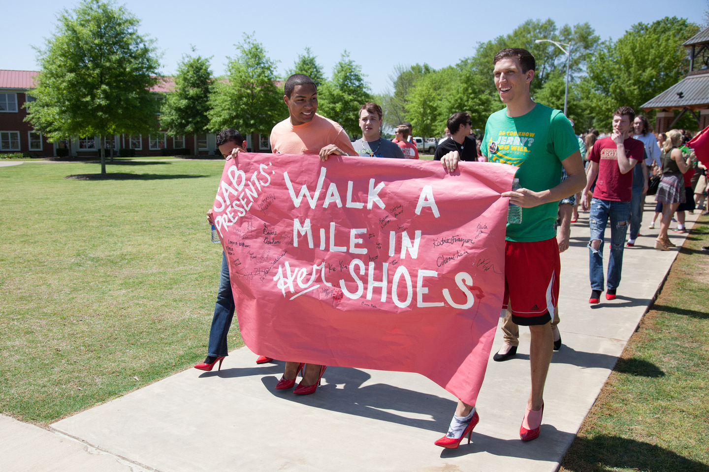 Walk a mile in her shoes men walking for rally photo
