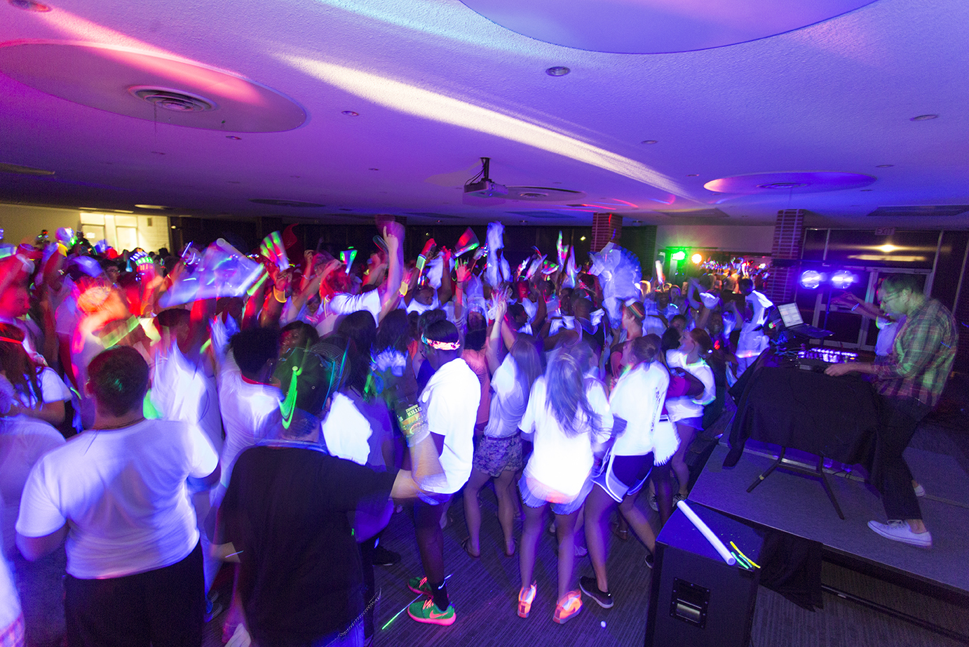Students having fun at the Black Light Party