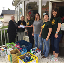 the staff senate presents the items from the green & gold hygiene drive to the Green & Gold Pantry