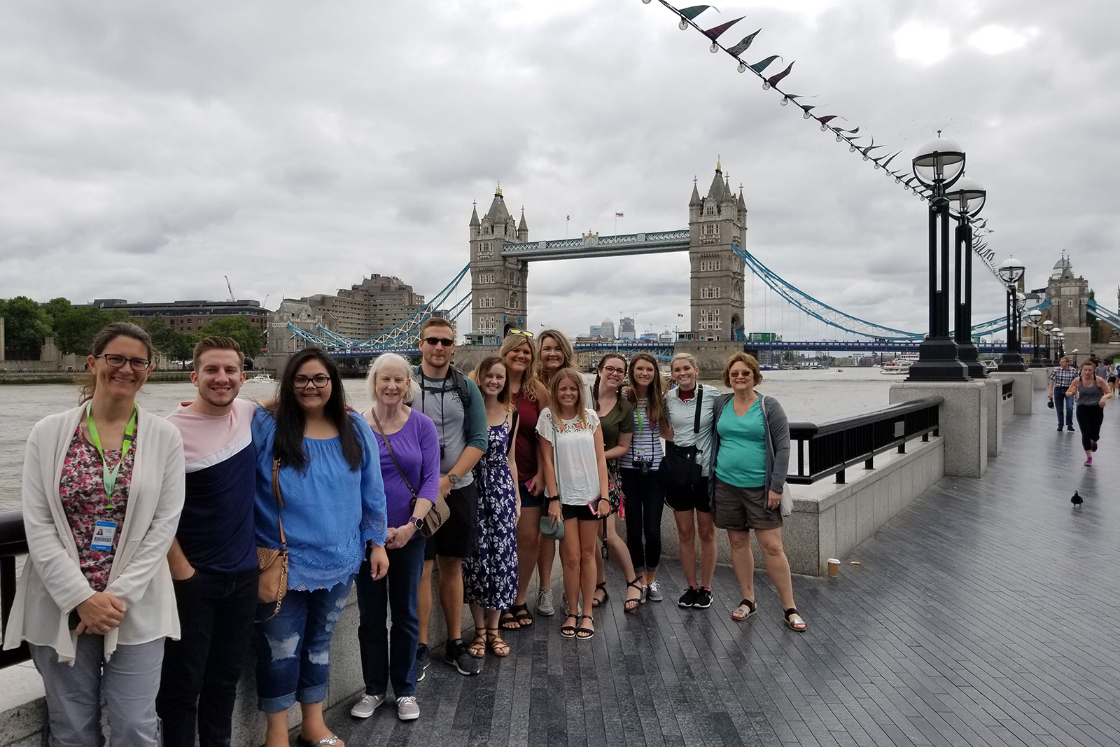 Students and faculty pause for a photo in front of the London Bridge